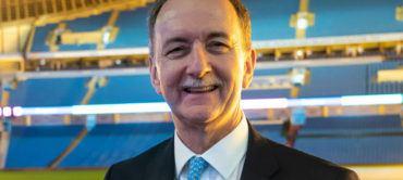 Queen honours Trust Director